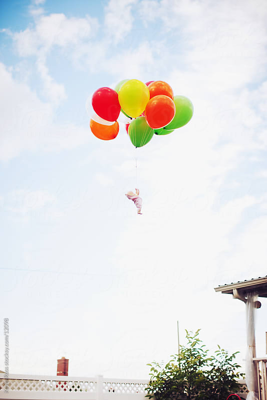 Floating Balloon Baby by Kevin Russ for Stocksy United
