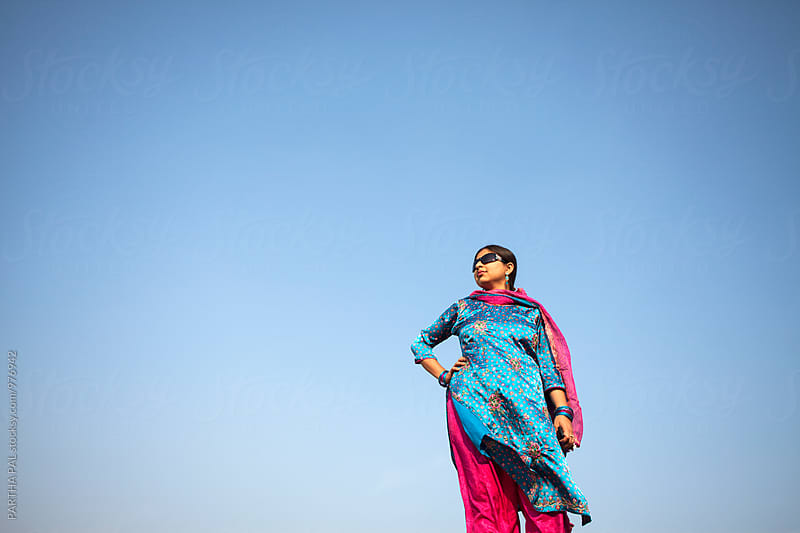 Beautiful Indian Woman with Traditional dress and wearing sun glass by PARTHA PAL for Stocksy United