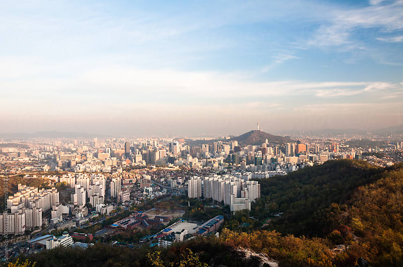 Seoul sunset from Mt Ansan by Shannon Aston for Stocksy United