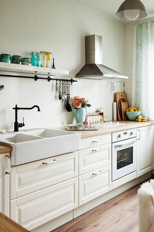 Beautifully decorated kitchen by Aleksandar Novoselski for Stocksy United