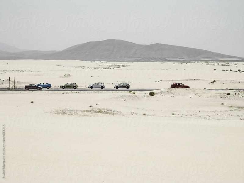 car in the desert  by Javier Márquez for Stocksy United