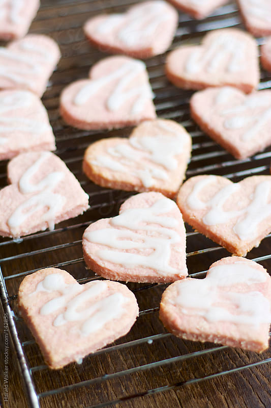 Pink heart shaped coconut cookies by Harald Walker for Stocksy United
