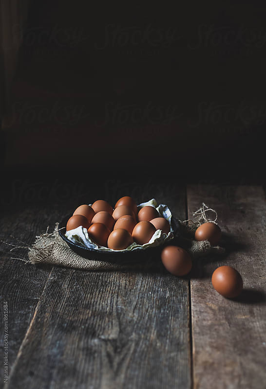 Eggs on a wooden table still life by Natasa Kukic for Stocksy United