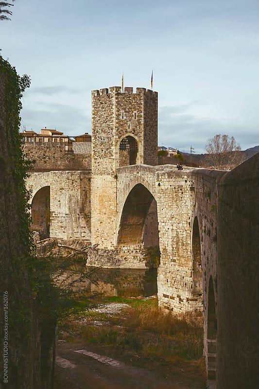 View of the medieval bridge of Besalu. Girona, Spain. by BONNINSTUDIO for Stocksy United