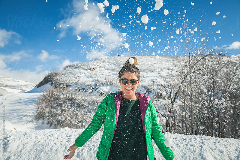 Woman having fun in snow. by RZ CREATIVE for Stocksy United