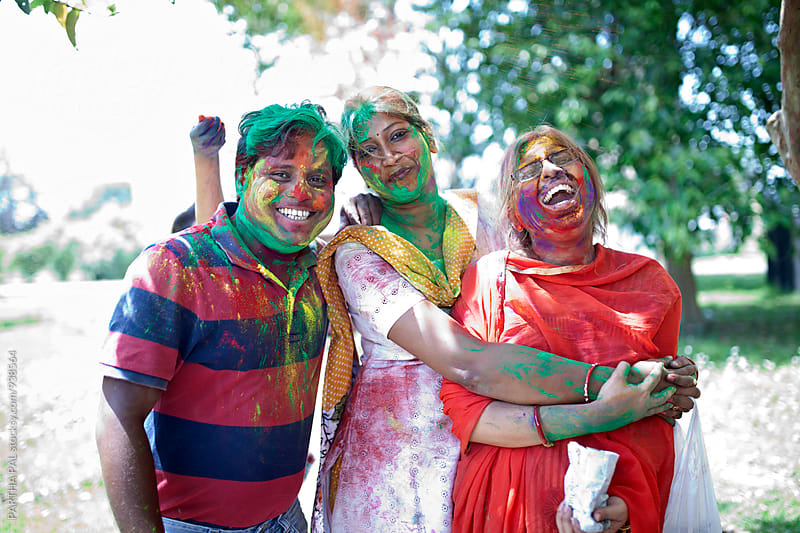 People enjoying and laughing in holi festival by PARTHA PAL for Stocksy United