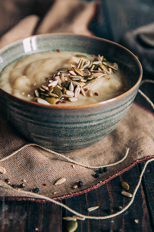 Cauliflower soup with seeds garnish by Nataša Mandić for Stocksy United