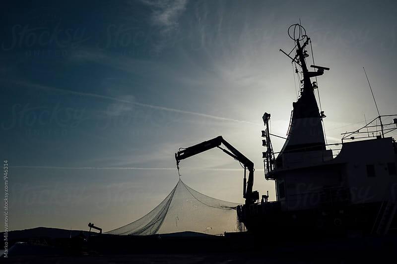 Big fishing boat at sea port by Marko Milovanović for Stocksy United