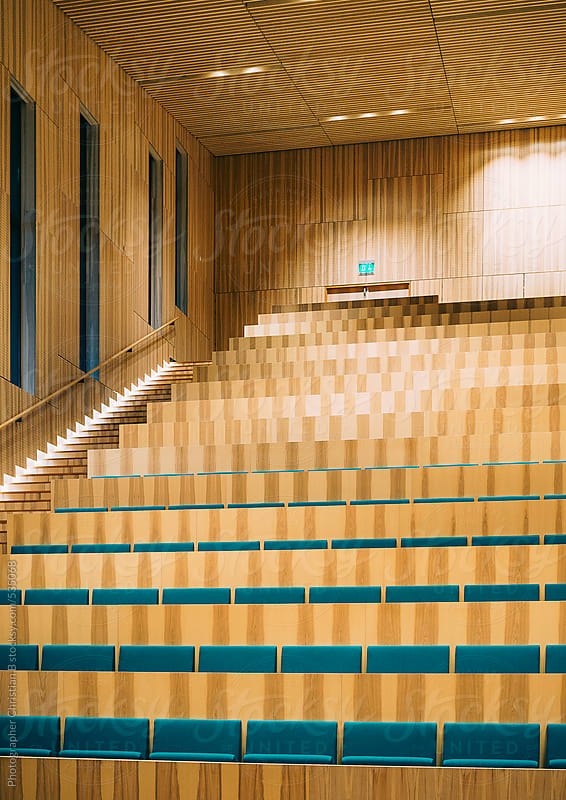 Auditorium with green seats by Photographer Christian B for Stocksy United