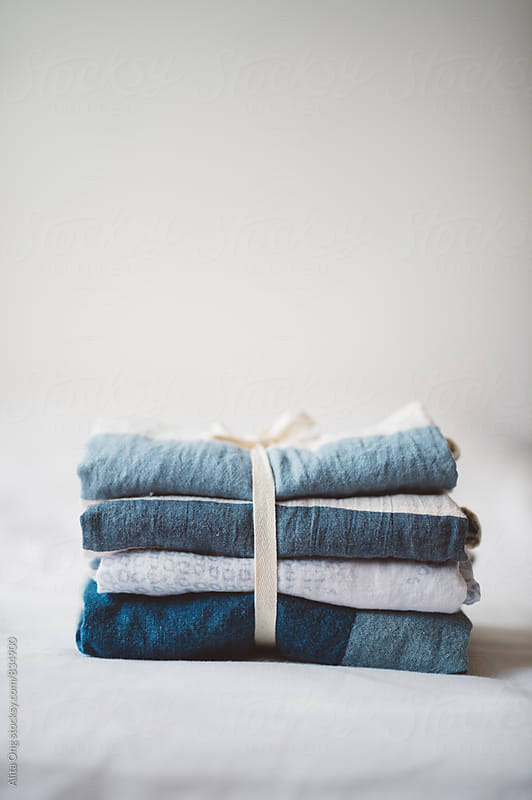 Stack of raw linen by Alita Ong for Stocksy United