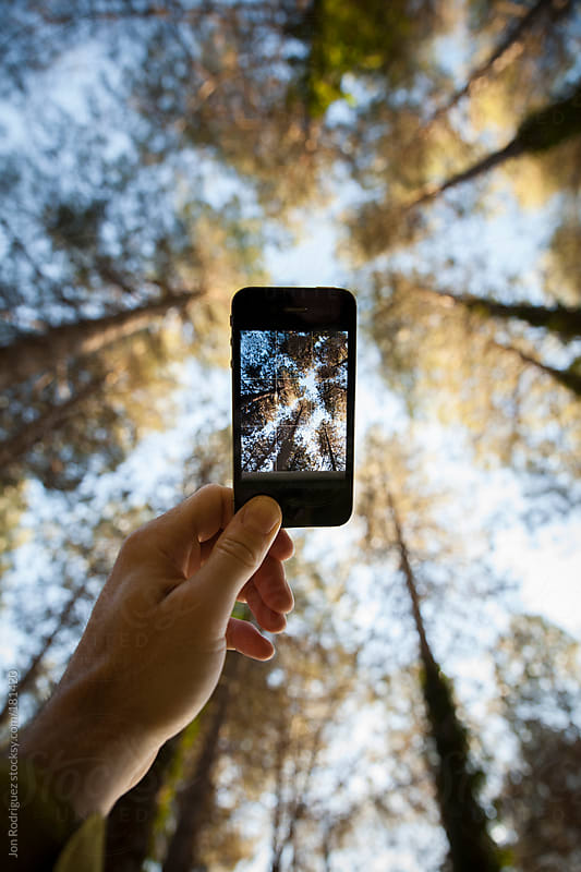 Taking a photo in the forest by Jon Rodriguez for Stocksy United