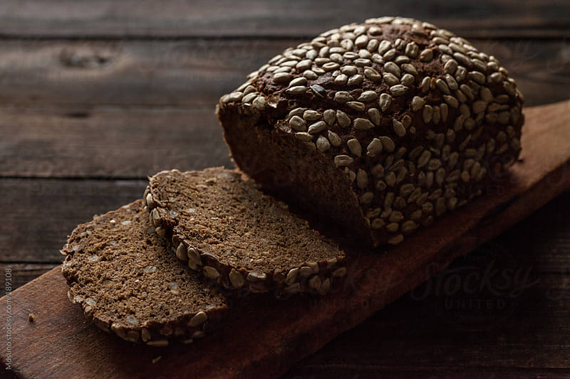 Fresh Bread on a Cutting Board by Mosuno for Stocksy United