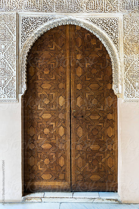 Carved wooden door in Arabic wall by ACALU Studio for Stocksy United