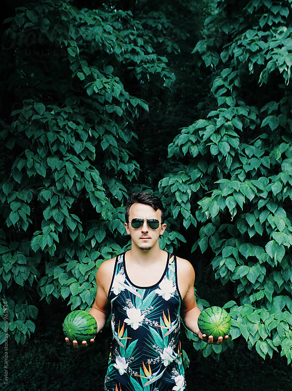 Man Holding Watermelons by Taylor Kampa for Stocksy United