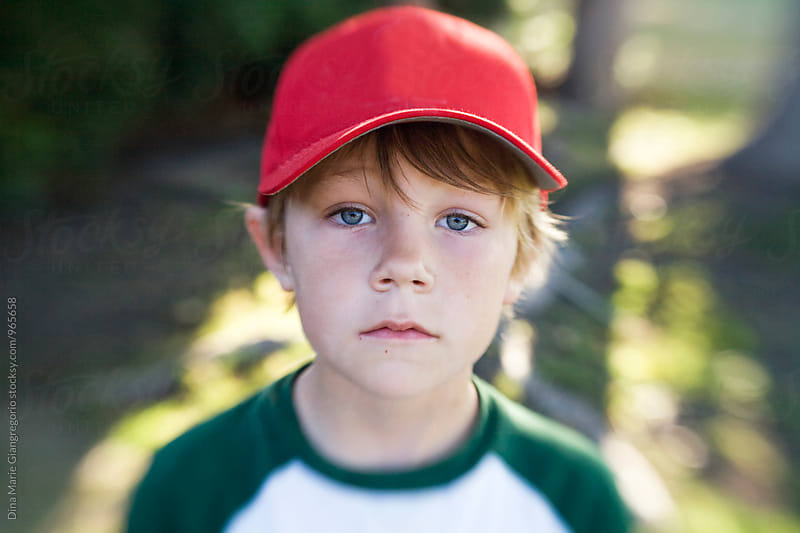 Boy Wearing Red Baseball Hat by Dina Giangregorio for Stocksy United