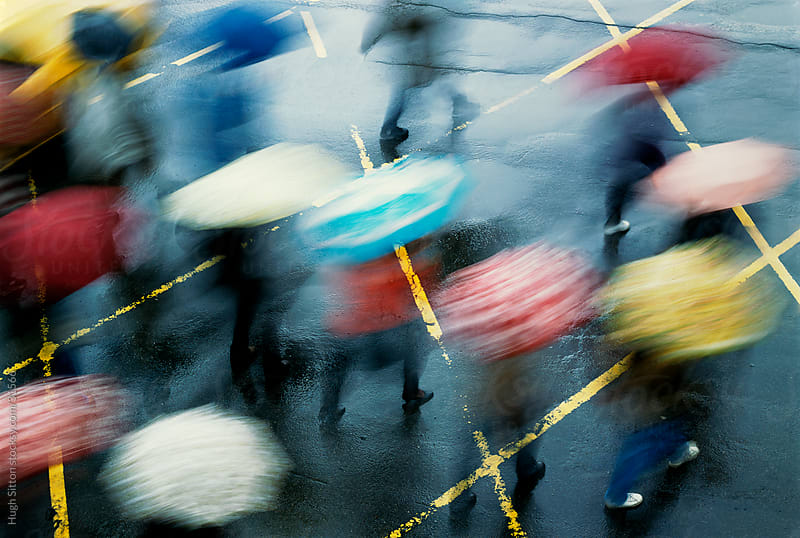 Blurred motion of people with umbrellas. Taipei. Taiwan. by Hugh Sitton for Stocksy United