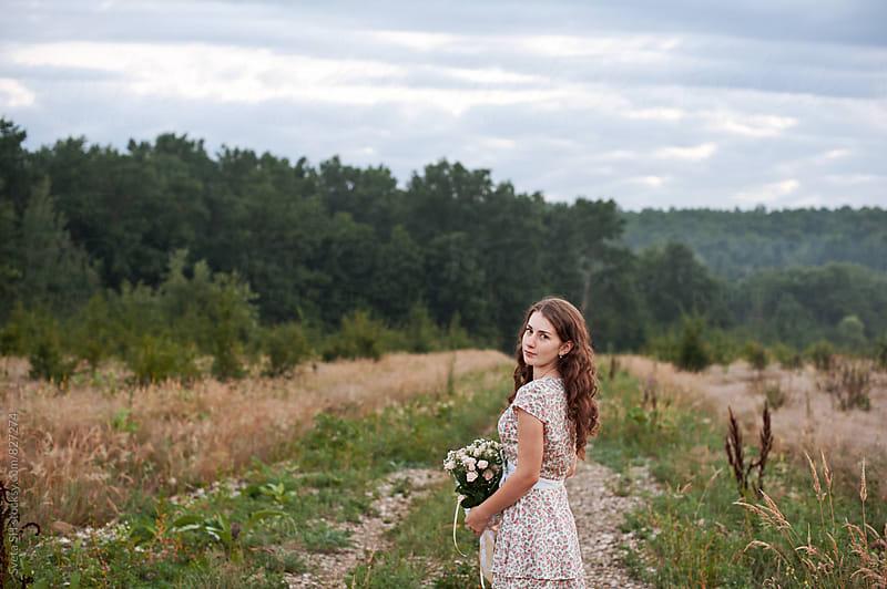 The girl in bright dress by Svetlana Shchemeleva for Stocksy United
