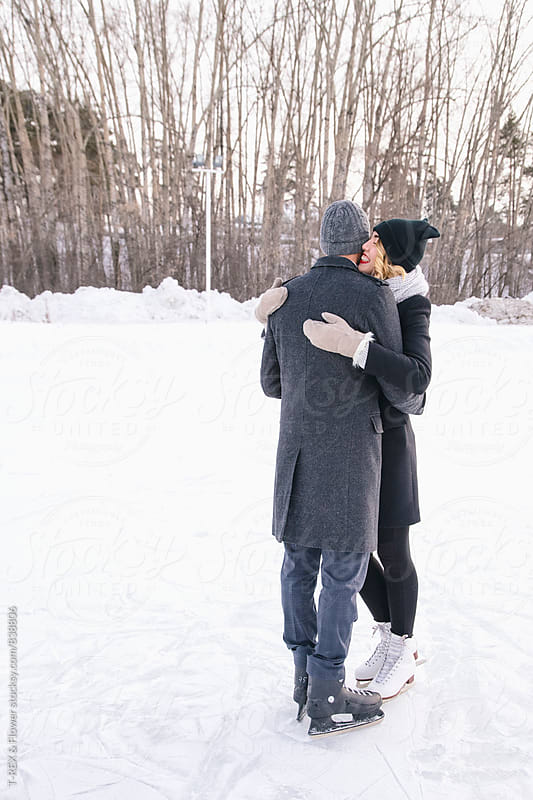 Young couple hugging on ice rink by Danil Nevsky for Stocksy United