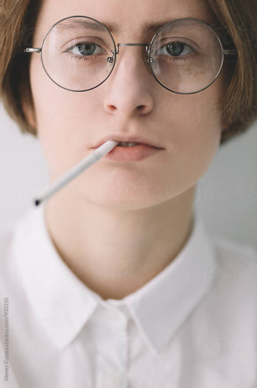 portrait of smoking androgyne  by Alexey Kuzma for Stocksy United