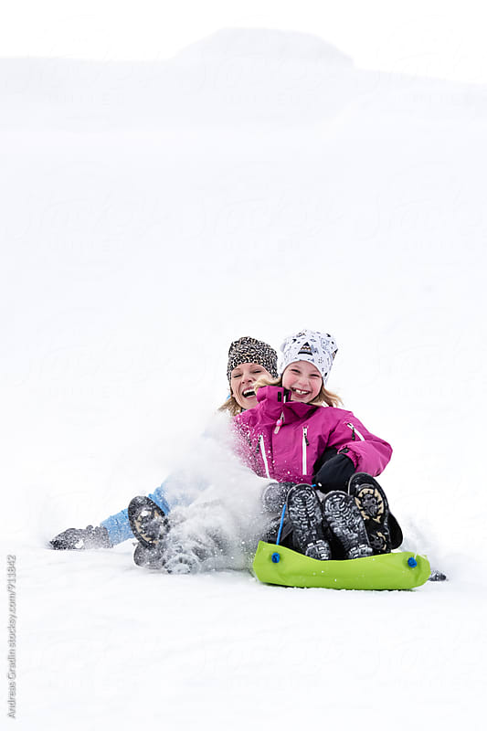mother and daughter winter fun daughter winter fun by Andreas Gradin for Stocksy United
