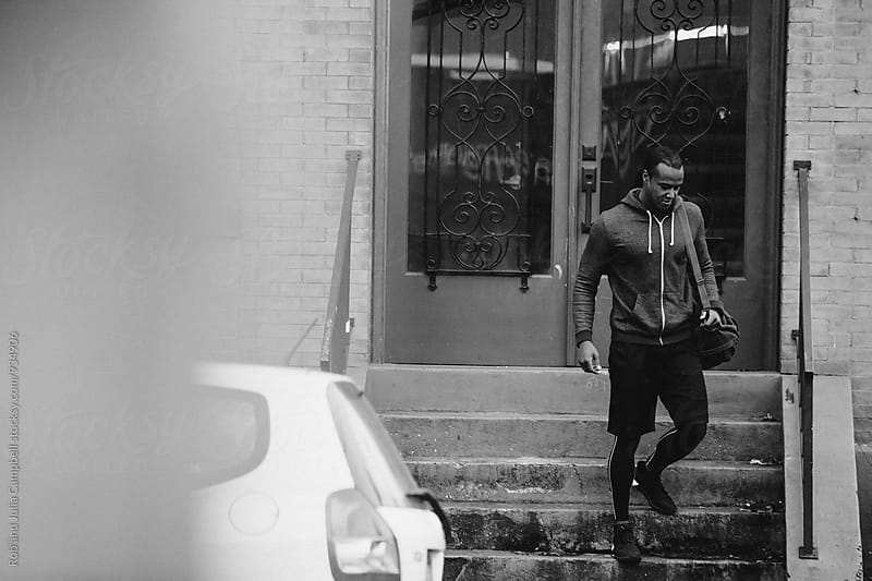 Fit, young black athlete heading to gym by Rob and Julia Campbell for Stocksy United