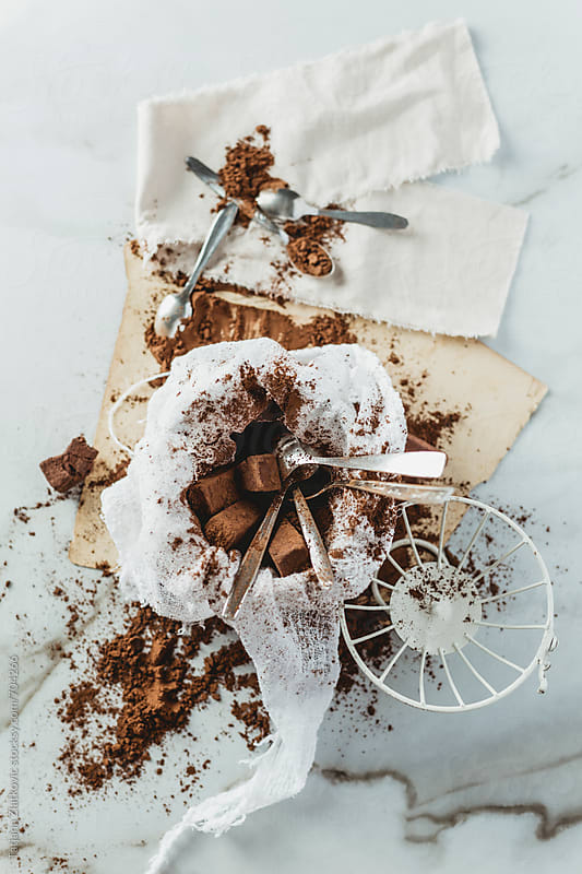 Cocoa truffles in vintage cage by Tatjana Zlatkovic for Stocksy United