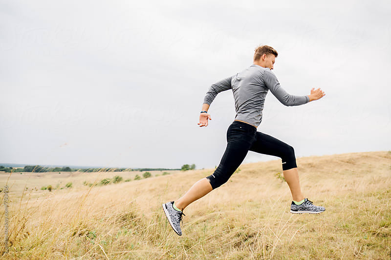 Fit Man in Sportswear Running  Outdoors by Lumina for Stocksy United