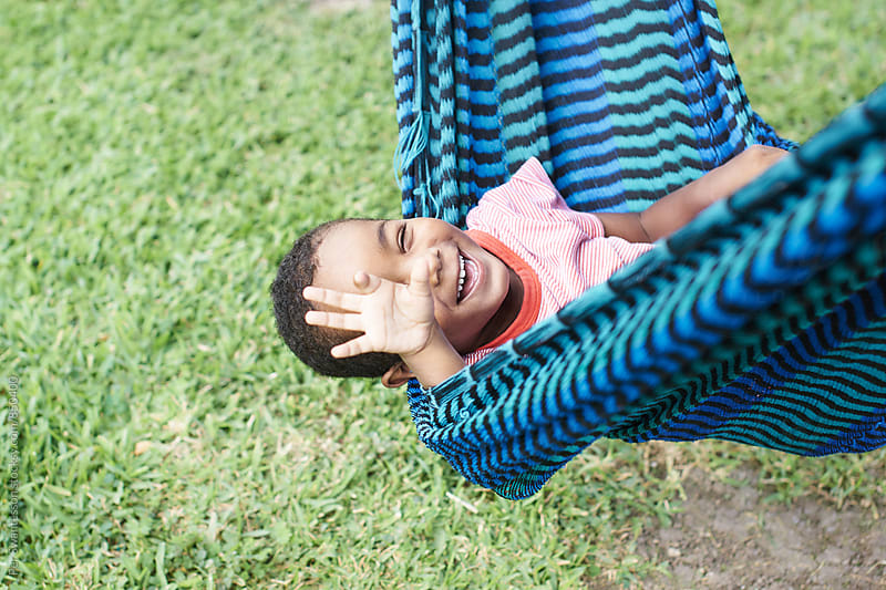 Boy having fun in a hammock by Per Swantesson for Stocksy United