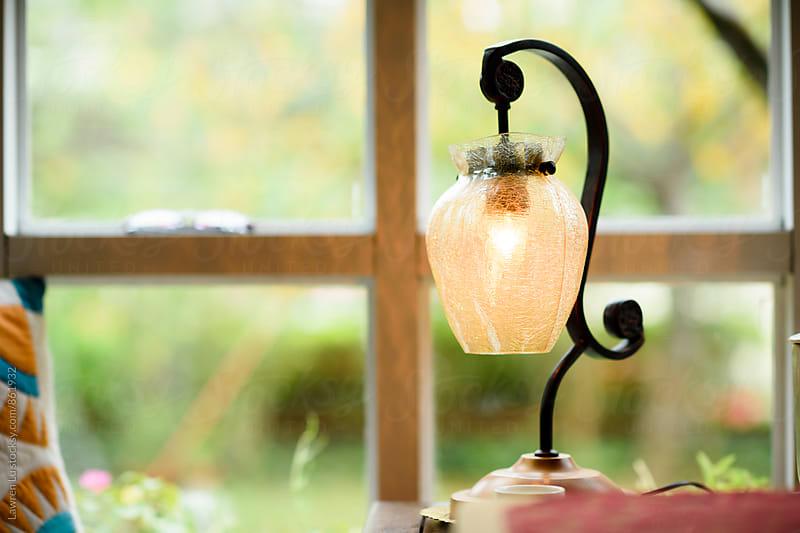 Retro design lamp beside window by Lawren Lu for Stocksy United