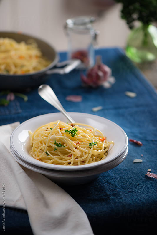 spaghetti garlic, pepper and olive oil by Laura Adani for Stocksy United