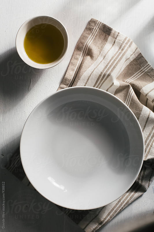 Empty plate settings by Davide Illini for Stocksy United