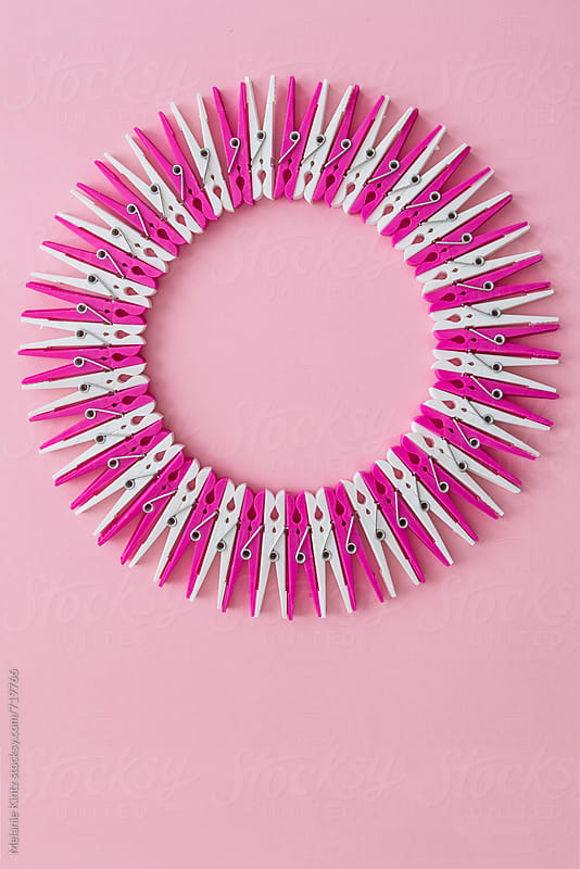 Pink and white clothespins form a circle by Melanie Kintz for Stocksy United