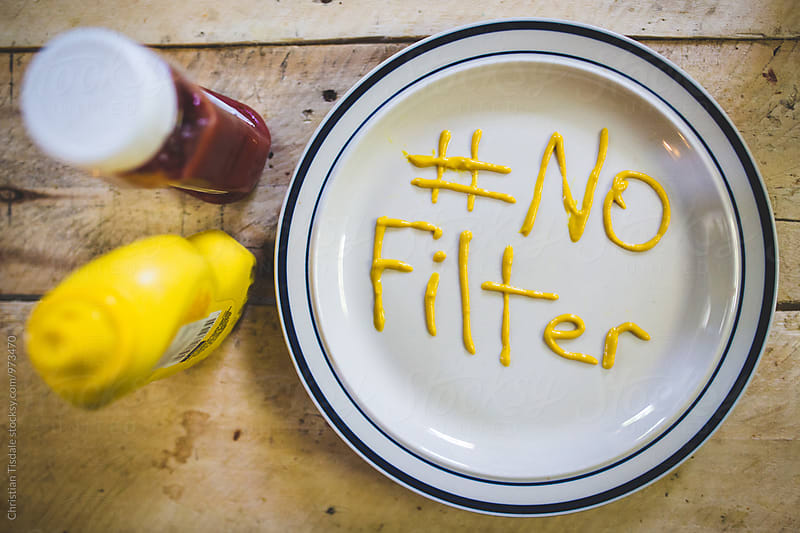 No Filter written in mustard on a plate by Christian Tisdale for Stocksy United