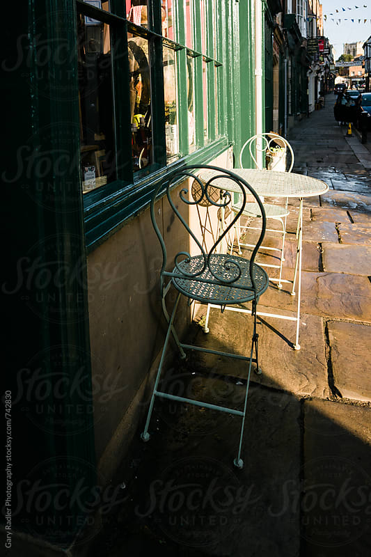 Two Street Cafe Chairs  by Gary Radler Photography for Stocksy United