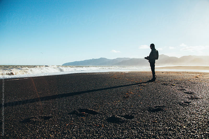 Photographer on the beach by Maximilian Guy McNair MacEwan for Stocksy United