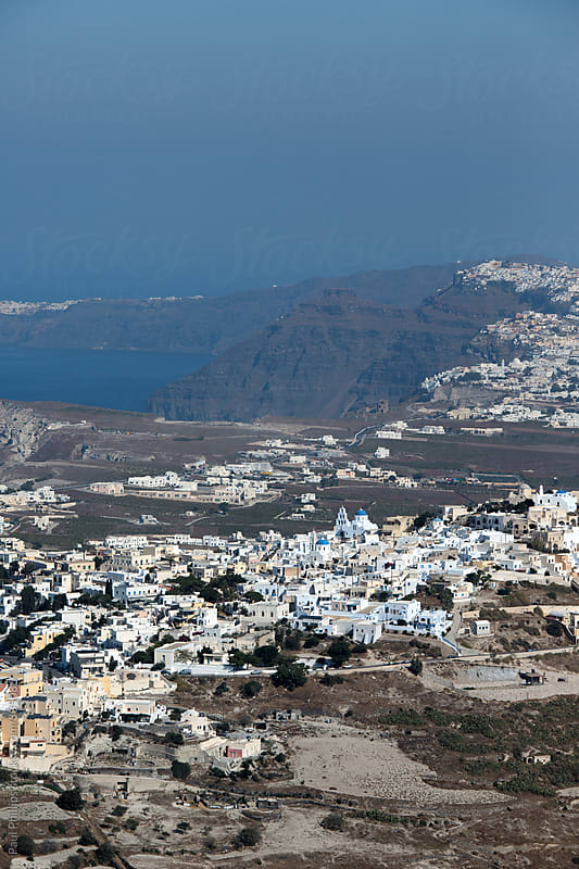 Aerial view of Santorini looking over Karterados and Thera with Oia in the background. by Paul Phillips for Stocksy United