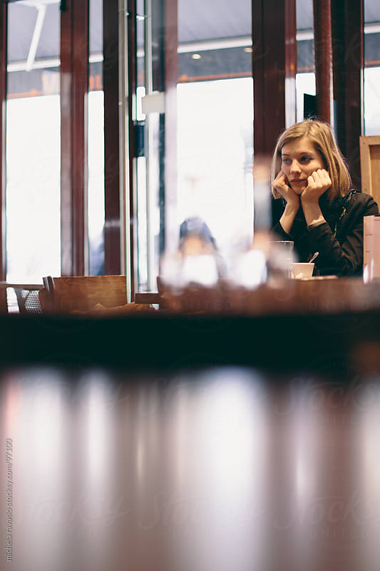 Young woman at a cafe by michela ravasio for Stocksy United