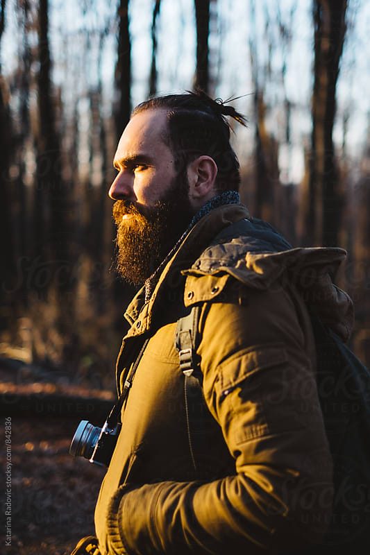Handsome Bearded Man Standing in the Woods by Katarina Radovic for Stocksy United