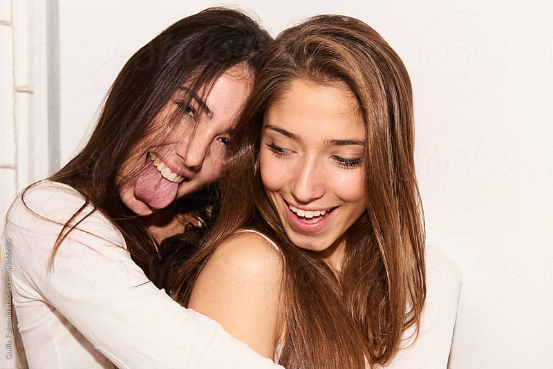 Two young women having fun together by Guille Faingold for Stocksy United