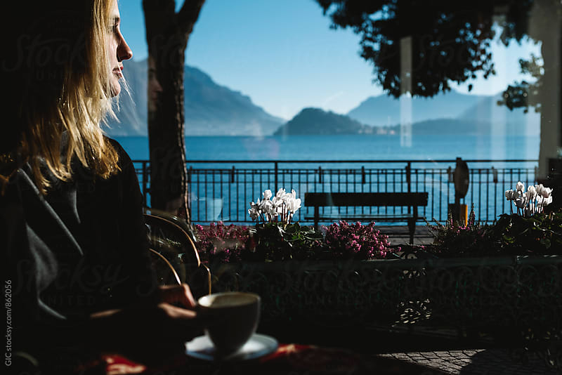 Young woman taking a coffee on the Lake Como by GIC for Stocksy United