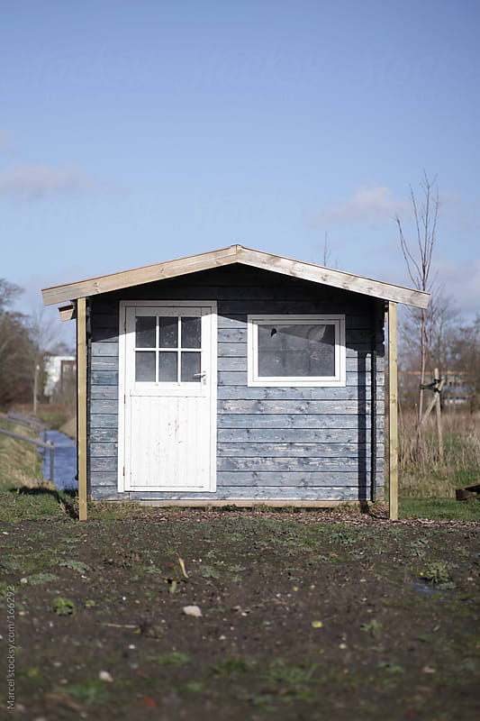 Garden shed on a vegetable garden by Marcel for Stocksy United