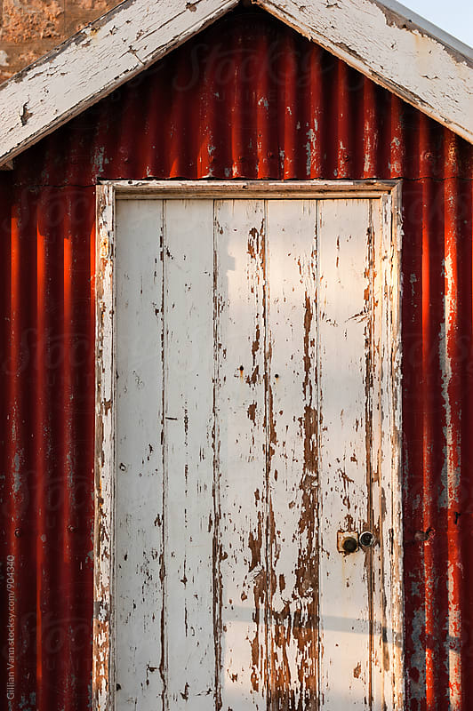 old weathered building with peeling paint by Gillian Vann for Stocksy United