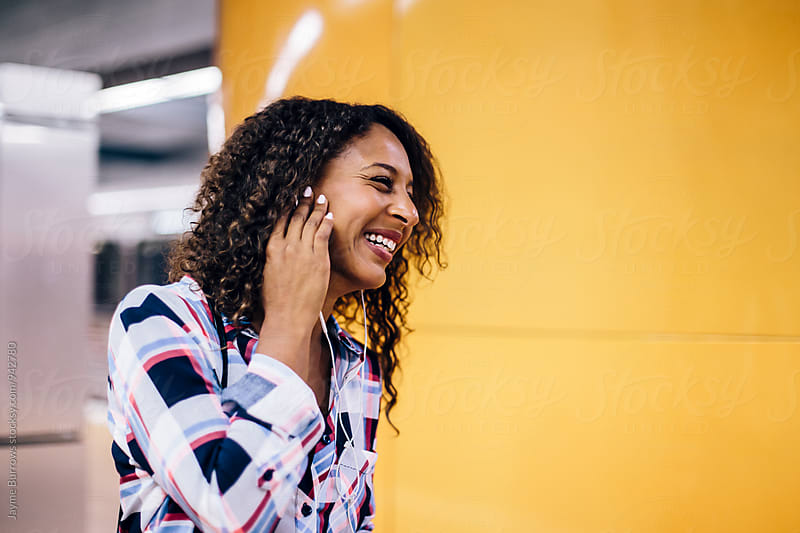 Adult Woman Smiling on Subway Platform by Jayme Burrows for Stocksy United