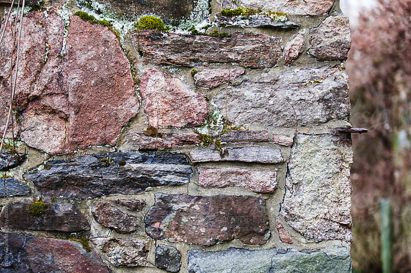 Detail of a stone wall by Holly Clark for Stocksy United