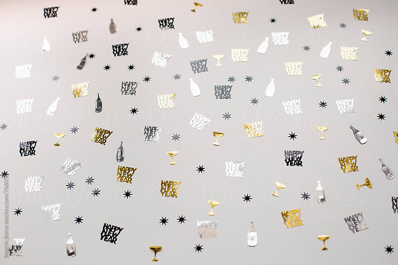Glasses, champagne and bottle confetti as a new year background by Beatrix Boros for Stocksy United
