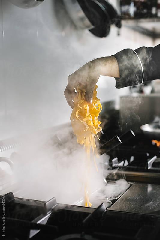 Chef Preparing Pasta by Lumina for Stocksy United
