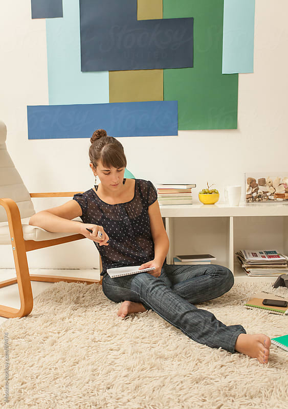 Woman Sitting on the Floor and Reading by Mosuno for Stocksy United