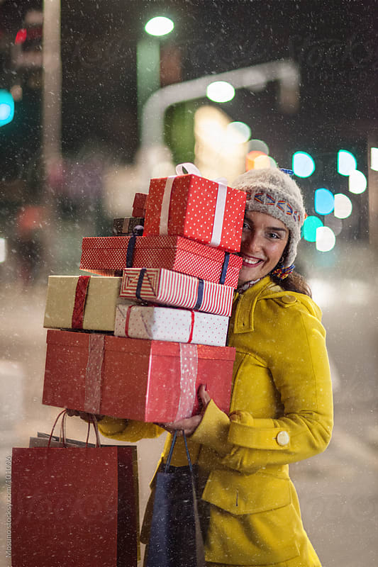 Woman Carrying Christmas Gifts by Mosuno for Stocksy United