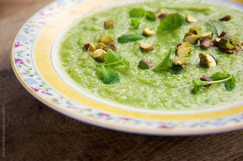Minty pea and parsnip soup by Harald Walker for Stocksy United