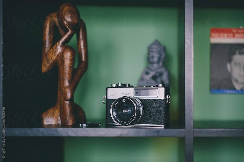Camera on a shelf by Oleg Zharsky for Stocksy United